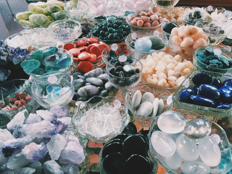 assorted gem stones in dishes