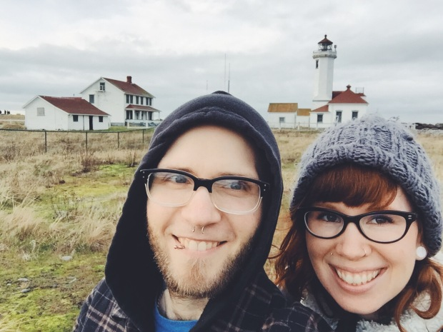 selfie of couple with fort worden lighthouse in background